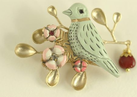 Blue bird pin made out of polymer clay, metal finding and a glass bead | by Elsita (Elsa Mora)