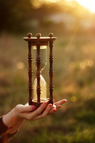 sunset sand hands hourglass wellactuallyitsahalfhourglass
