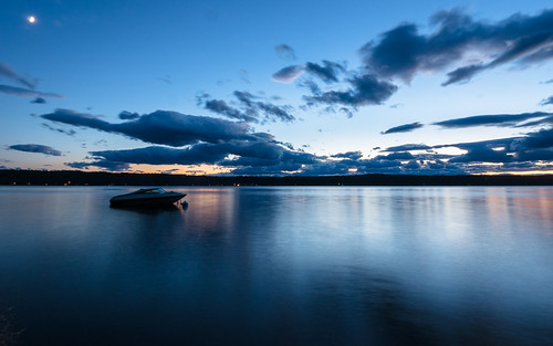 sunset sky lake reflection water mirror boat long peaceful zuiko afterglow 918mm