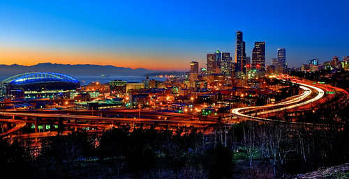seattle city longexposure sunset motion cars skyline buildings lights moving nikon neon traffic pugetsound seahawks headlight qwestfield hdr taillight smithtower olympicmountains columbiatower d700 surrealize