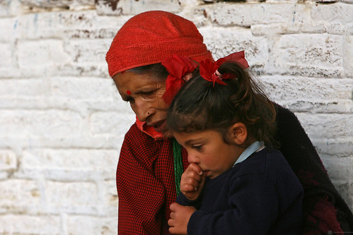 Woman and young girl outside of a school in Kaski, Nepal | by World Bank Photo Collection