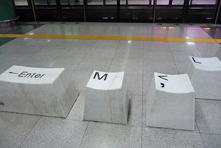 Keyboard key seats Luo Hu MTR Station Shenzhen China   by dcmaster
