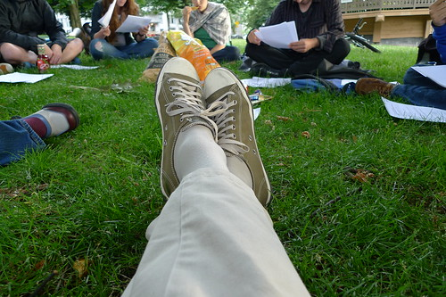 Photo of a VPSN team member's feet, as they recline on the grass at Alexandra Park.