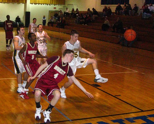 In this 2009 game, Dougherty's Art Comas (4) and Kennedy-Kenrick's Brad Miller track a loose ball. Both schools closed in 2010. | by tedtee308