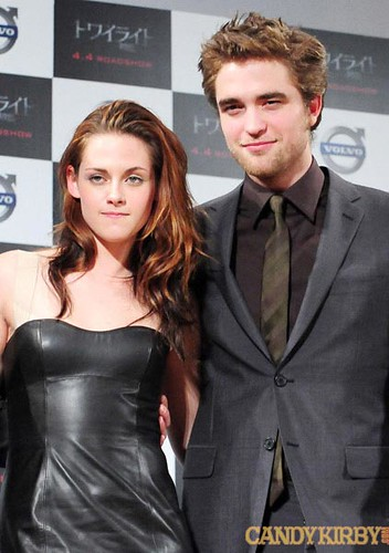 a2626228aad2 Kristen Stewart in a Black Leather Dress and Robert Pattinson at the