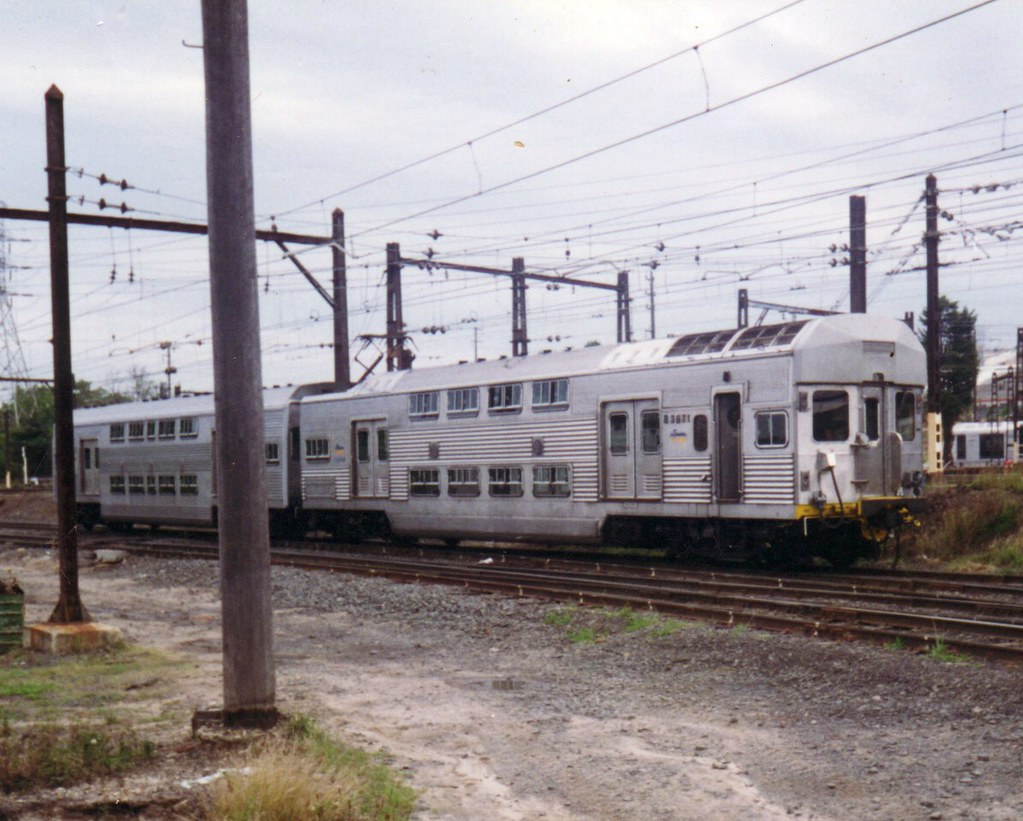 Cityrail Comeng power car C3871 and a trailer pottering about at Flemington MC by zed.fitzhume