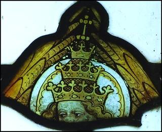 angel wearing a triple-crown