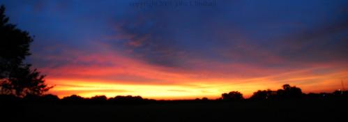 sunset red sky orange black silhouette yellow clouds photoshop manipulated landscape evening nikon louisiana purple scenic 2009 orton d60 9749