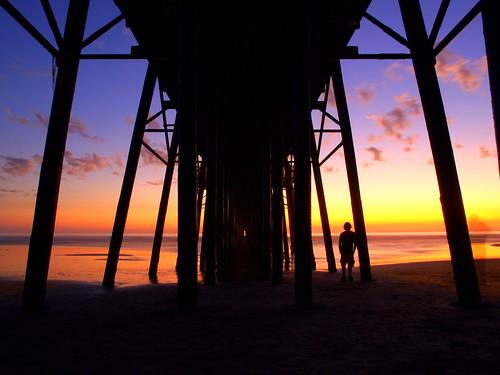 longexposure sunset portrait reflection clouds self pier colorful vibrant tide low under olympus oceanside pilings pillars zuiko e500 f3556 1442mm