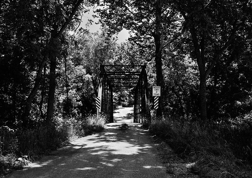 road bridge trees sky rust shadows oxidation weathered roadsigns gravel underbrush unpaintedmetal