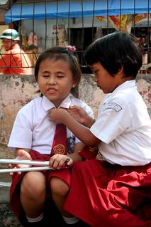 Children in their uniform outside of their school