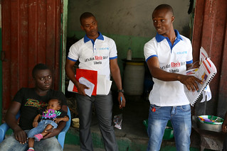 UNICEF coordinators and volunteers walk from house to house   by World Bank Photo Collection