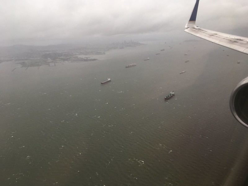 Boats in formation in SF Bay, sheltering from the storm but aligned by the wind