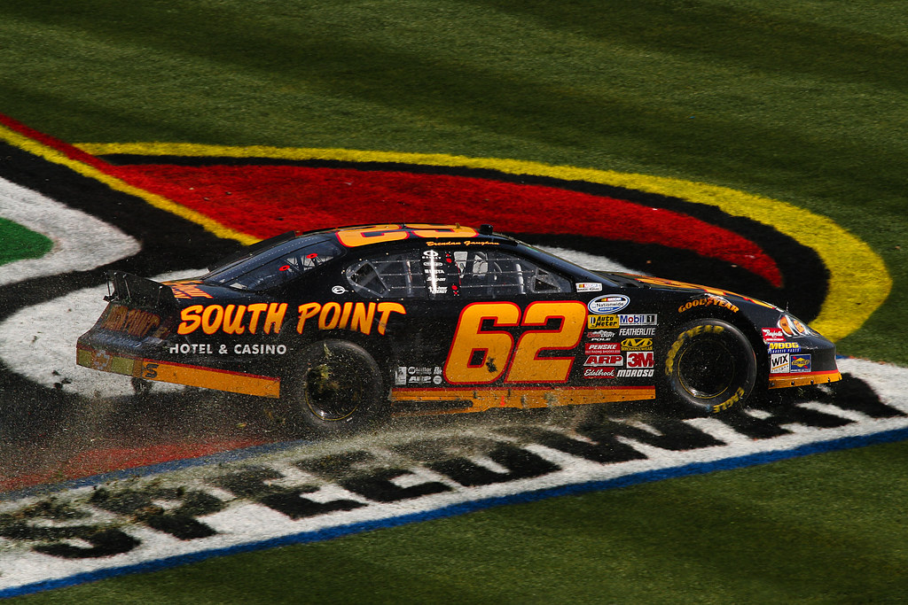 Brendan Gaughan spins across the infield grass at the O'Reilly 300 at Texas Motor Speedway by sidehike
