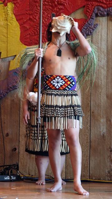 Maori dancer blowing his own horn