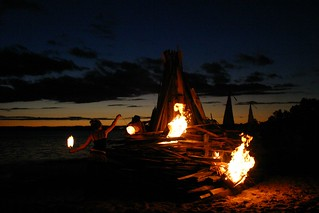 Fire Twirling at Canton Beach at Sunset - lighting the bonfire 2 | by John Englart (Takver)