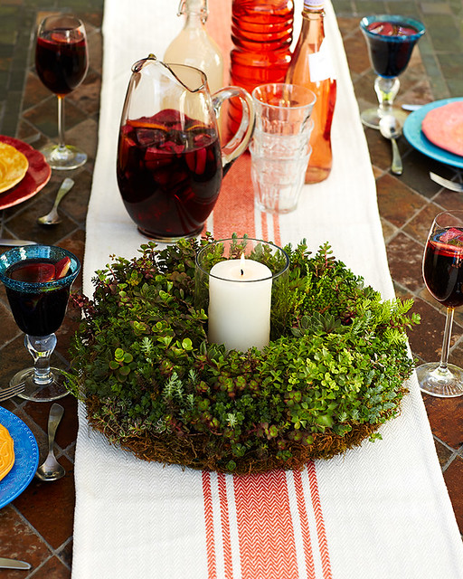 living succulent wreath centerpiece with candle with pitcher of cocktails on table with runner