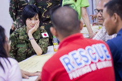 1st Lt. Yukiko Takeuchi listens to a Filipino first responder talk about disaster relief strategies at Capiz State University. (U.S. Navy/MCC Christopher E. Tucker)