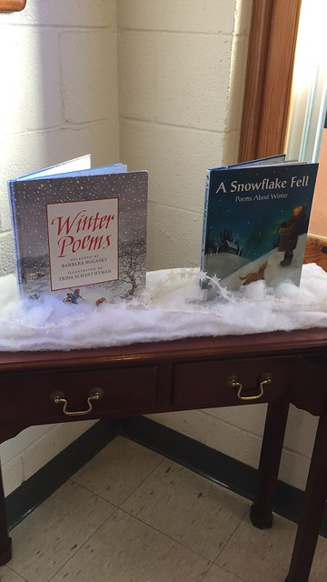 #preK Reading suggestions in my child's preschool today. 📚 Start with at least two books a day, start them young, & read even to babies. ❤️👶 #WinterPoems #ASnowflakeFell #winter #season #reading #poems