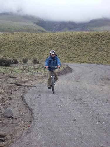 Kathy biking down the Volcano | by Neil and Kathy Carey