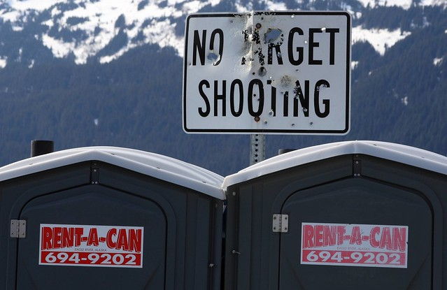 Typical Alaskan scene - another mutilated sign