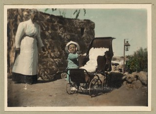 Vintage Picture of a Child Standing Outside, Along the Side of,  a Baby Carriage Buggy | by Beverly & Pack