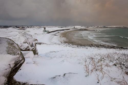 winter snow seascape cold beach bay guernsey lancresse