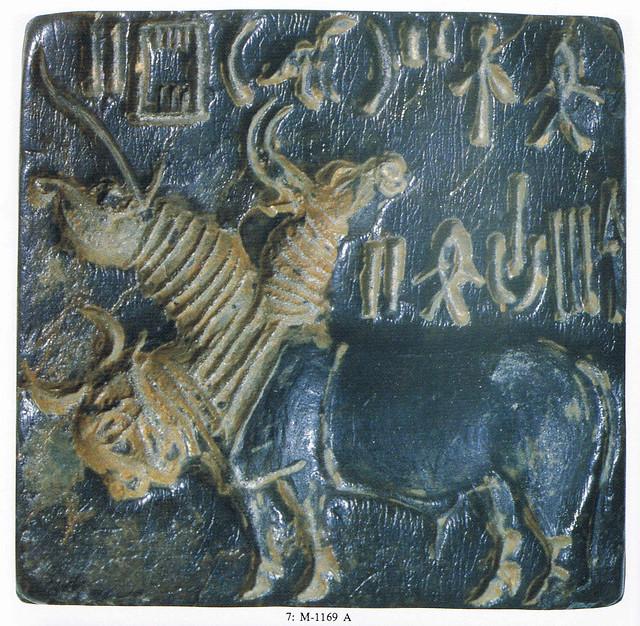 3 headed animal with one unicorn-head