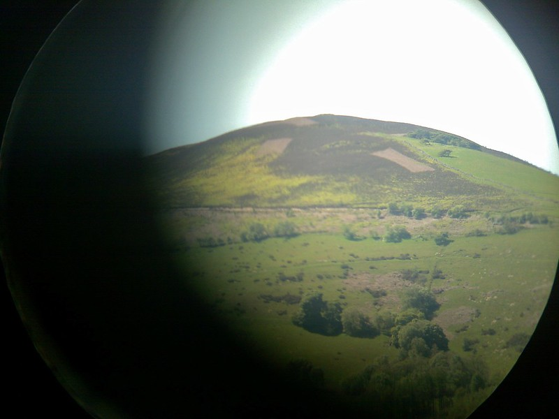 Through binoculars