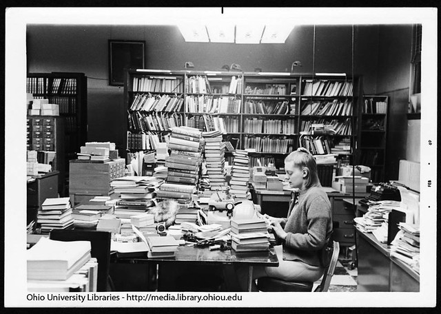 Anita Ozols typing in Cataloging Department of Ohio University's Chubb Library, 1969