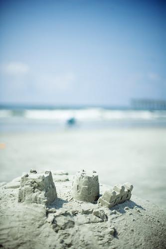 ocean blue sky castle beach clouds sand sandcastle