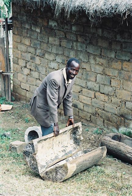 Eliya Mwampamba with beehive