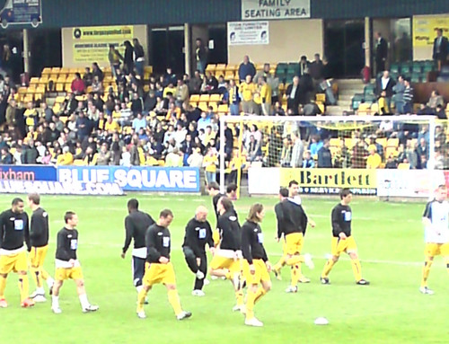 Plainmoor Stadium: Torquay United players complete their pre-match warm-up exercises
