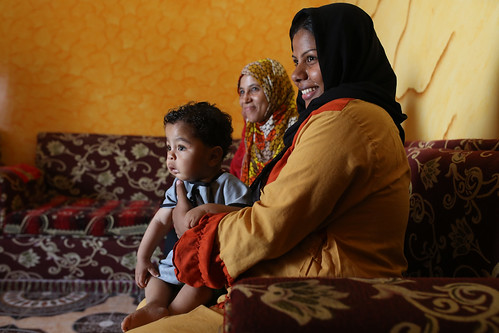 Faten Ahmed holds her one year old son | by World Bank Photo Collection
