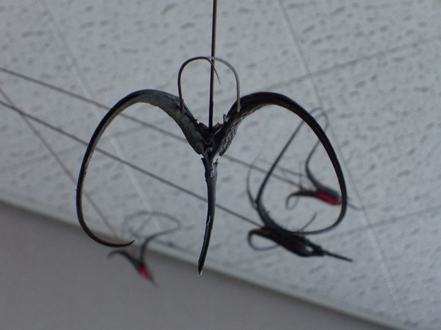 Devil Dance mobile made of wire, stone, and devil claws by John Stickler