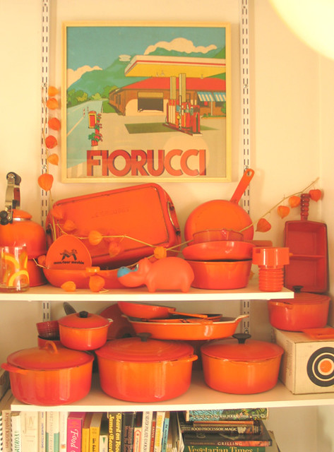Le Creuset 'Flame' cast iron collection + vintage poster in Wary Meyers' kitchen