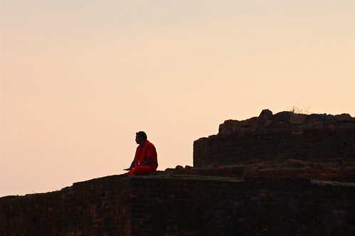 sunset red india man ruins sitting indian bricks pilgrim vizag visakhapatnam thotlakonda buddhistheritagesite
