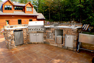 Outdoor kitchen with fridge, grill, side burners, ice make ...