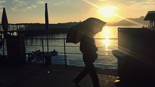 hongkong saikung waterfront harbour sunshine sunrise umbrella silhouette