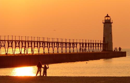 sunset sun lighthouse lake water silhouette metal pier outdoor michigan scenic lakemichigan panasonic catwalk manistee breakwater settingsun michiganlighthouse us31 outdoorbeauty scenicmichigan fz18 scenicsnotjustlandscapes jimflix llmsmimanistee