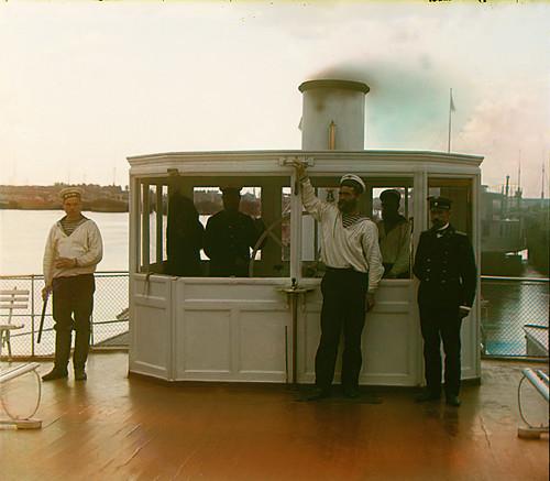 At the wheelhouse of Sheksna steamer, 1909   by Sergey Prokudin-Gorsky
