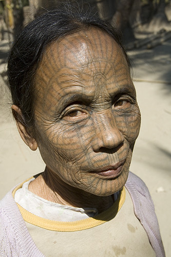 chin woman with typically tattooed face