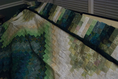 The first side with both borders.  It never ceases to amaze me how much darker that green looks when it's placed directly against the lighter colors -- when in the quilt itself, it blends nicely.