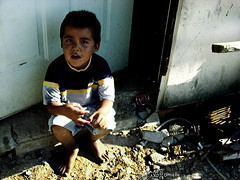 Child at his home entrance