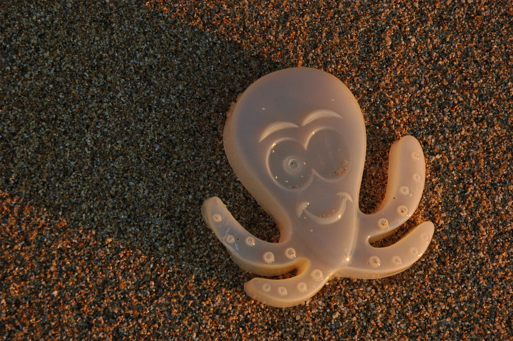 Plastic octopus thrown back by the Pacific Ocean at Gray Whale Cove, California Coast, USA