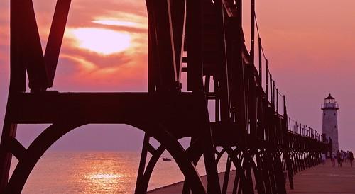 sunset sky sun lighthouse lake water metal clouds pier outdoor michigan scenic lakemichigan panasonic explore catwalk manistee breakwater settingsun michiganlighthouse us31 outdoorbeauty scenicmichigan fz18 scenicsnotjustlandscapes jimflix llmsmimanistee