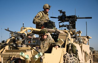 Soldiers in Jackal 2 All Terrain Vehicle on Patrol in Gereshk, Afghanistan | by Defence Images