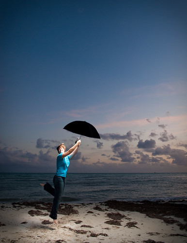 sunset selfportrait beach umbrella jump jumping flash abi bahiahonda flyaway jumpshot sb800 thankseveryone 365days strobist yayexplore