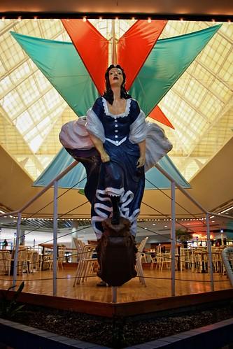 wood blue woman statue lady angel mall shopping dead wings texas dress chairs corpuschristi empty sails skylight deck bow tables railing foodcourt figurehead billowing sunrisemall dyingmall orangecreations