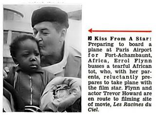 Errol Flynn Kisses Tearful African Tot - Jet Magazine, March 27, 1958